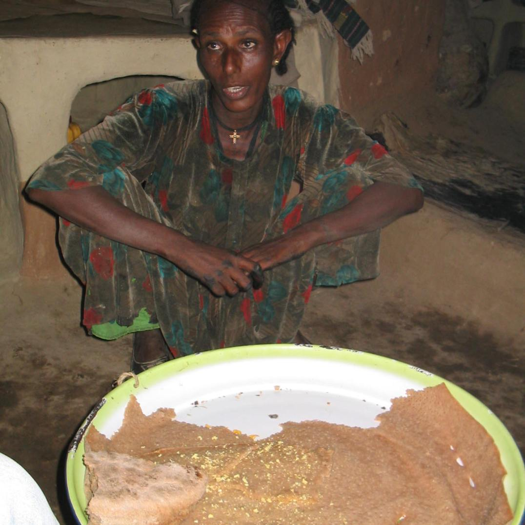 After work invitation to eat traditional Injera pancake (2005)