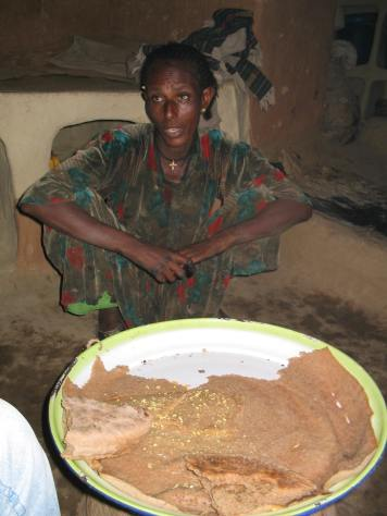 After work invitation to eat traditional Injera pancake (2005)
